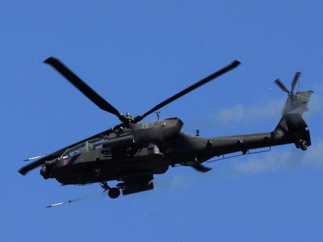 A US Apache helicopter fires as it takes part in the