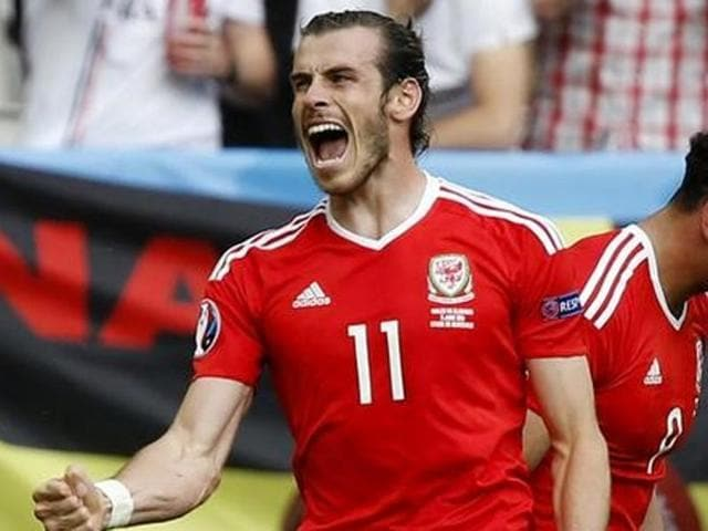 Wales' Gareth Bale celebrates after Hal Robson-Kanu scores their second goal.