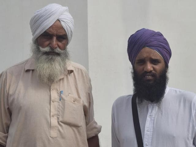 "Gurjant Singh (left) and Gora Singh, named as ""accused"" in the 'bir' theft and desecration case by a group of Sikhs last year, at Burj Jawahar Singh Wala village in Faridkot district on Wednesday."