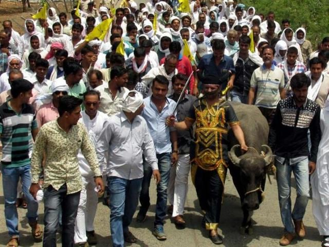 Farmers' leader Prince Patel dressed as Yamraj leads a protest march in Harda district. Agitated farmers were demanding compensation under crop insurance scheme for crop damage in the last five years.