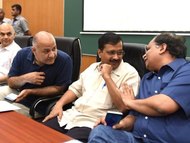Delhi chief minister Arvind Kejriwal interacts with deputy CM Manish Sisodia and  cabinet minister Satendr Garg at Baba Sahib Bhimrao Ambedkar Medical College  in Delhi.