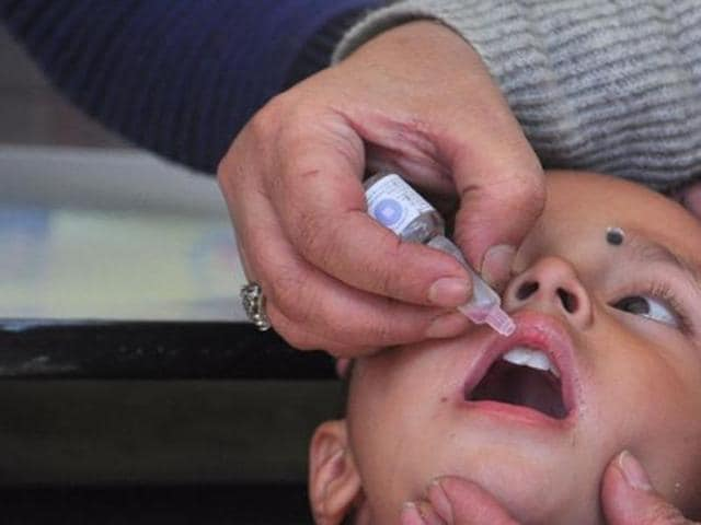 (File Photo) A medical staff administers polio drops at polio eradication campaign.