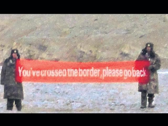 Indian troops warning intruders along the border with China.