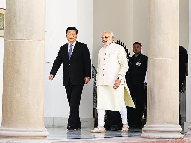 File photo of China's President Xi Jinping and Prime Minister Narendra Modi sharing a quiet moment at Sabarmati Ashram in Ahmedabad.