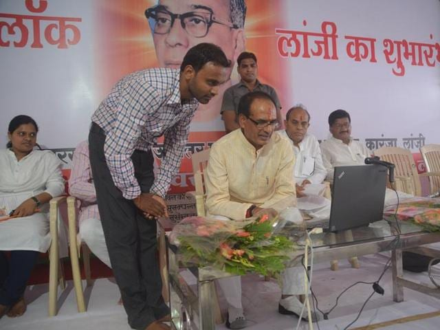 Chief minister Shivraj Singh Chouhan interacts with village sarpanchs through video-conferencing at Karanja village in Balaghat district on Tuesday.