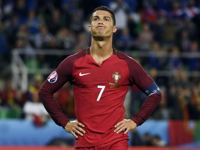 Portugal's forward Cristiano Ronaldo reacts during the Euro 2016 group F football match between Portugal and Iceland at the Geoffroy-Guichard stadium in Saint-Etienne.