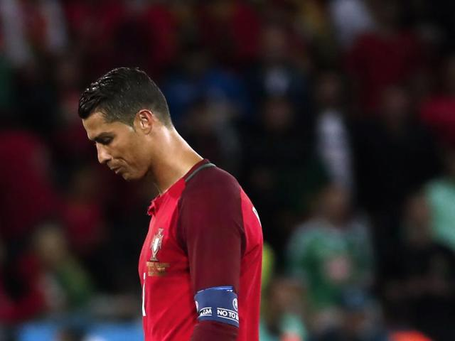 Portugal's forward Cristiano Ronaldo reacts after the Euro 2016 group F football match between Portugal and Iceland at the Geoffroy-Guichard stadium in Saint-Etienne.