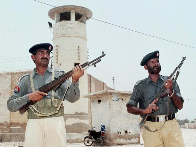 Pakistani policemen guard the central jail in Hyderabad, 160 km (100 miles) from Karachi, in this July 10, 2002 file photo.