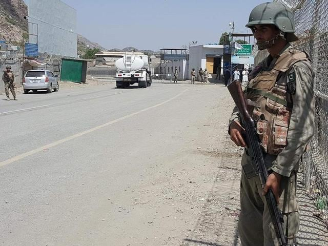 Pakistani soldiers patrol at the Torkham crossing between Pakistan and Afghanistan in Pakistan's Khyber Agency on June 14, 2016. Afghan and Pakistani forces clashed in an escalation of tensions between the neighbouring countries, killing at least three people and forcing the closure of the main border crossing, officials said.