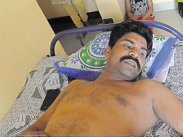 BSF constable Mahesh Muwel who was partially paralysed after he was brutally thrashed by four unidentified persons, including two in police uniform, at Dhar recently.