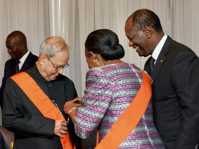President Pranab Mukherjee being honoured by Ivory Coast President Alassane Ouattara (R) with the National Order of the Republic of Ivory Coast, the highest civilian award of the West African country at the Presidential Palace in Republic of Cote D'ivoire, Abidjan.(PTI Photo)