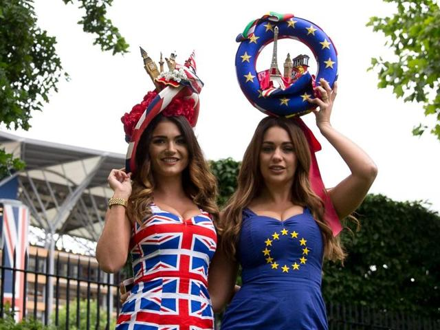 Models promoting betting for a bookmaker for the upcoming EU referendum pose for photographers at the Royal Ascot horse racing meet in Ascot, west of London, on Tuesday.