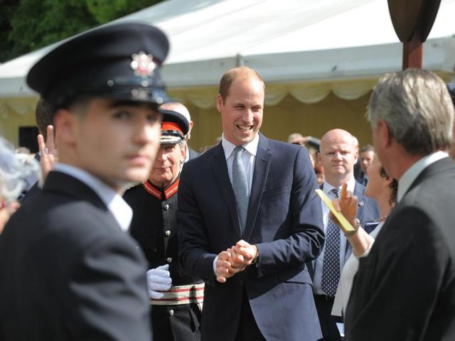 Britain's Prince William, Duke of Cambridge, attends a garden party hosted by the secretary of state for Northern Ireland, Theresa Villiers at Hillsborough Castle in Hillsborough.