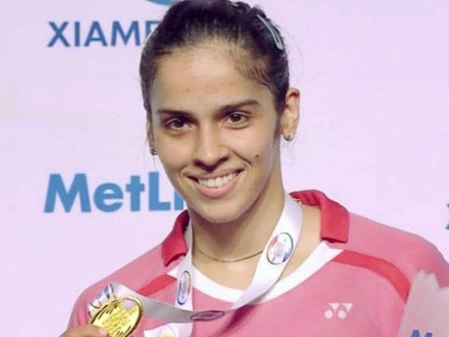 India's ace shuttler Saina Nehwal with the trophy after winning her second Australian Open Superseries title by defeating China's Sun Yu in the Australian Open finals in Sydney.