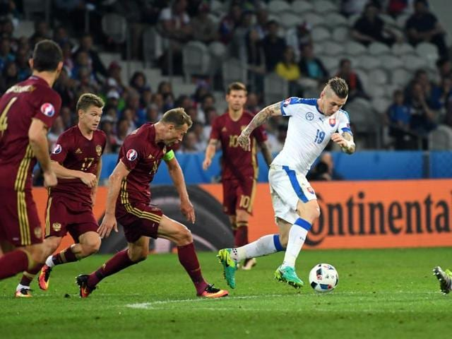 Slovakia's Juraj Kucka (2nd right) runs with the ball during the Euro 2016 Group B football match between Russia and Slovakia at the Pierre Mauroy stadium in Villeneuve d'Ascq, near Lille, France.