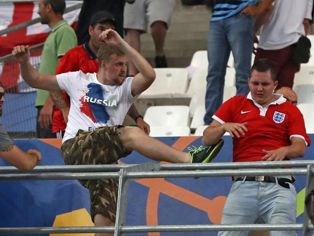 Russian supporters attack England fans at the end of the game in Marseille on Saturday.