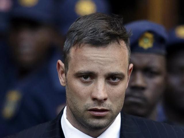Oscar Pistorius leaves the high court in Pretoria, South Africa, after his sentencing proceedings.