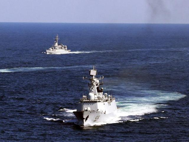 In this file photo, Chinese navy vessels take part in a drill in the waters off Zhoushan.