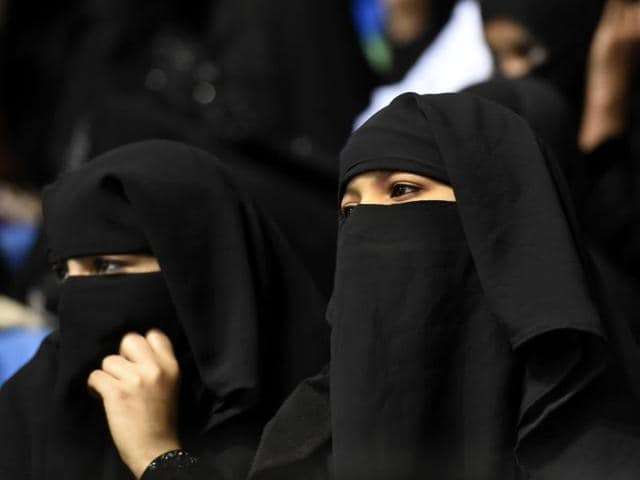 Muslim women take part at the All India Anti Terrorism Sunni Conference at Talkatora Stadum in New Delhi on February 8