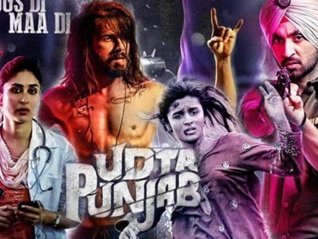 A youth walks past the poster of Hindi film Udta Punjab in Mumbai.