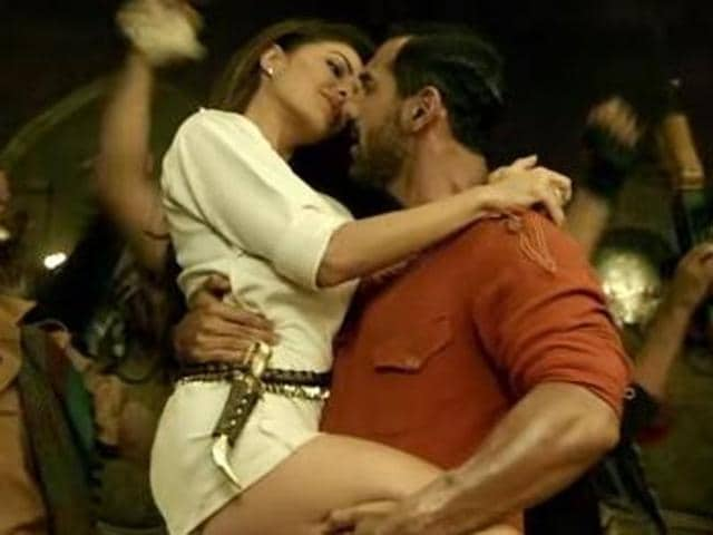 Jacqueline and John in a still from the video of the song in question from Dishoom. She is seen wearing a kirpan-like dagger on her.