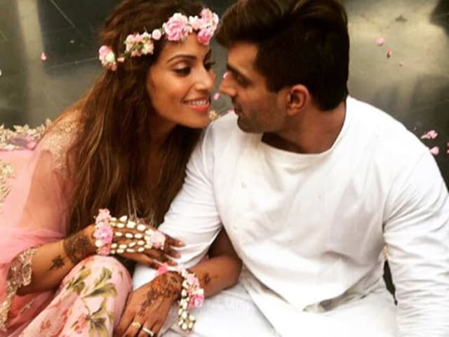 Actor Bipasha Basu posted adorable pictures with husband, actor Karan Singh Grover, during her wedding celebrations.