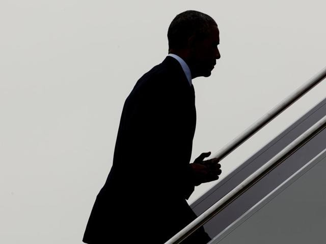 President Barack Obama returns a salute as he boards Air Force One on Thursday at Andrews Air Force Base. Obama will visit Orlando to pay respect to the victims of the Pulse nightclub shooting and meet families of victims of the attack.