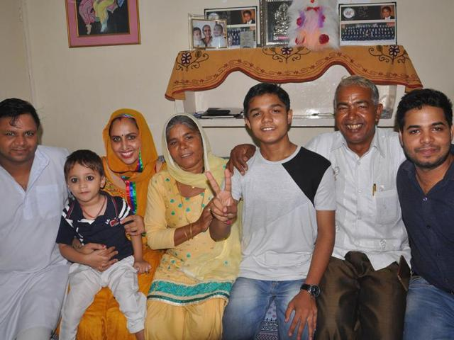 Surinder Grover (third from right) celebrating with his family in Chandigarh on Wednesday.