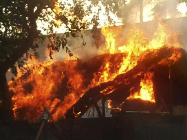 A house is set on fire after clashes between the police and encroachers at Jawahar Bagh in Mathura.