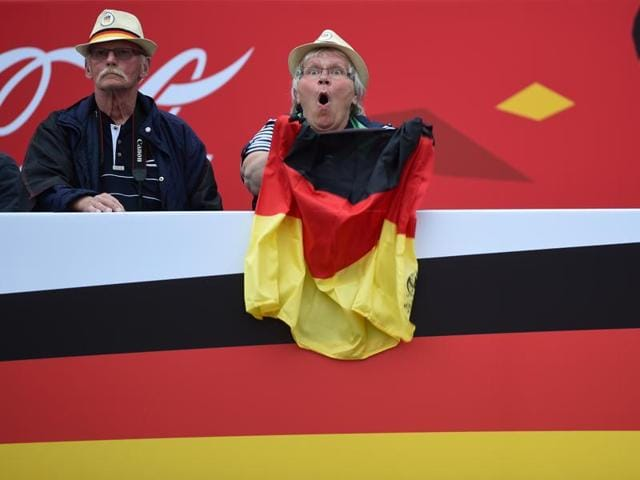 A German supporter reacts while following the match during a public viewing for the first Euro 2016 match of the German national football team against Ukraine in front of the Brandenburger Tor in Berlin, Germany.