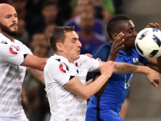 Albania's midfielder Ermir Lenjani (L) and France's midfielder N'Golo Kante (C) vie for the ball during the Euro 2016 group A football match between France and Albania at the Velodrome stadium in Marseille on Wednesday.