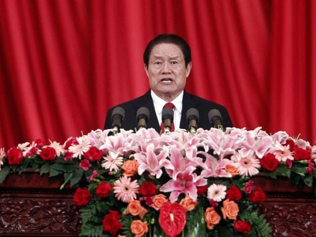 File photo from May 2012 shows then-Politburo standing committee member Zhou Yongkang delivering a speech at a meeting in Beijing. China has jailed the son of its former security chief for 18 years and his wife for nine, state media reported. Zhou Yongkang is the highest official to be sentenced in a sweeping anti-graft campaign championed by President Xi Jinping.