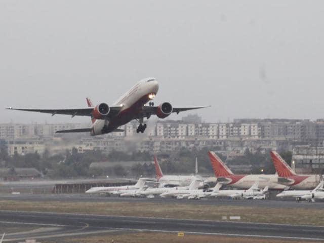 An aircraft prepares to land at the Chhatrapati Shivaji airport, in Mumbai, June 15, 2016.