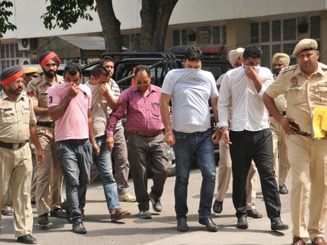Police taking the alleged kidnappers to a court in Jalandhar on Wednesday.