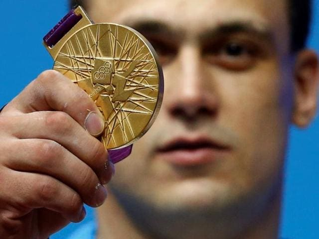 Kazakhstan's Ilya Ilyin poses with his gold medal of the men's 94kg weightlifting competition at the ExCel venue at the London 2012 Olympic Games.