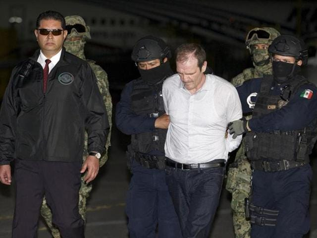 This photo released by Mexico's General Attorney press office, shows veteran drug lord Hector