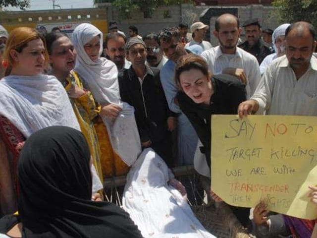 Pakistani transgender Paro (right) mourns the death of her colleague Alesha in Peshawar on May 25. Alesha was shot several times, allegedly by her boyfriend, who was later arrested. She died of her wounds three days after being admitted to hospital. Her friends said she was neglected by doctors and medical professionals, who taunted her, rather than treating her.