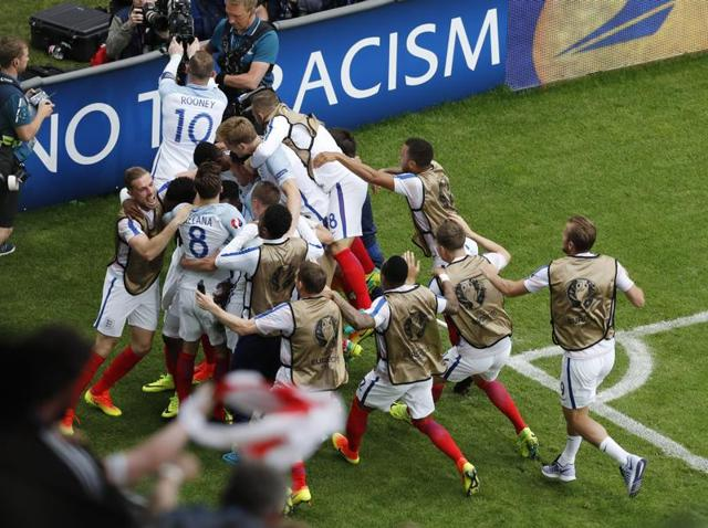 Daniel Sturridge (# 15) scores the winner for England.