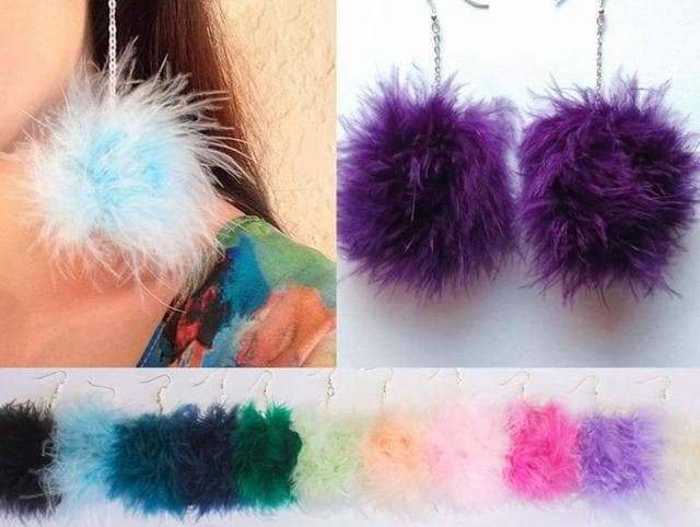 Pom-poms are the rage this summer. They are ruling every possible accessory and outfit.