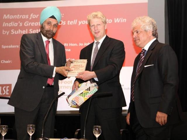 Britain's universities and science minister Jo Johnson (centre)released the new book by Suhel Seth (right) at the London School of Economics on Thursday. On the left is Indian high commissioner Navtej Sarna.