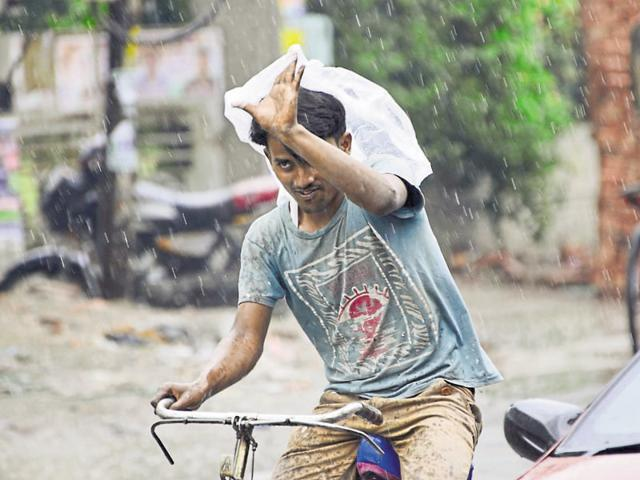 A man making his way through the rain in Amritsar on Friday.