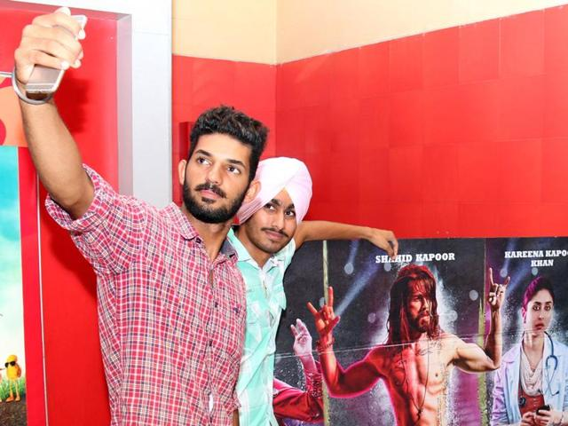 Fans taking a selfie with 'Udta Punjab' posters at a mall in Bathinda on Friday.