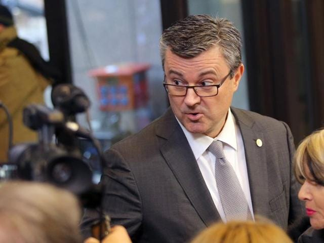In this file photo, Croatian Prime Minister Tihomir Oreskovic, speaks with journalists as he arrives for an EU summit in Brussels.