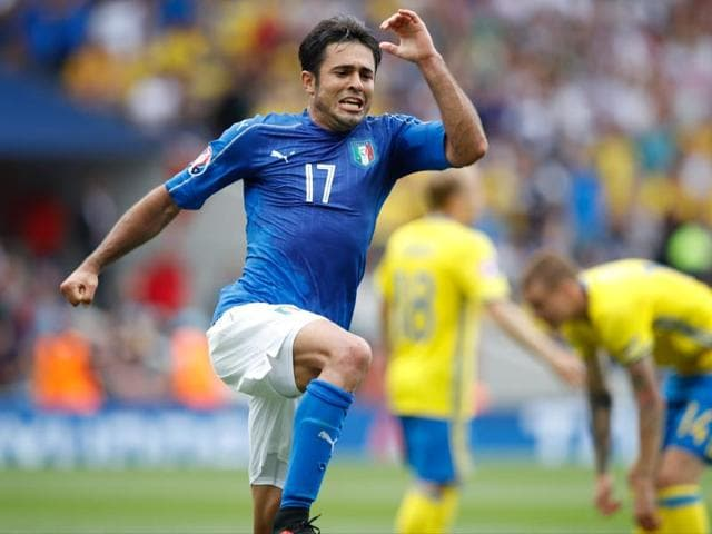 Eder, centre, scored two minutes from time to seal Italy's berth in the last 16.