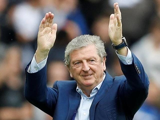England head coach Roy Hodgson applauds fans after the game against Wales.