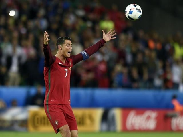 Portugal's forward Cristiano Ronaldo plays the ball during the Euro 2016 group F football match between Portugal and Iceland at the Geoffroy-Guichard stadium in Saint-Etienne.