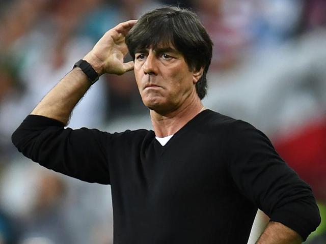 Germany's midfielder Sami Khedira (C-R) commits a foul on Poland's forward Arkadiusz Milik.