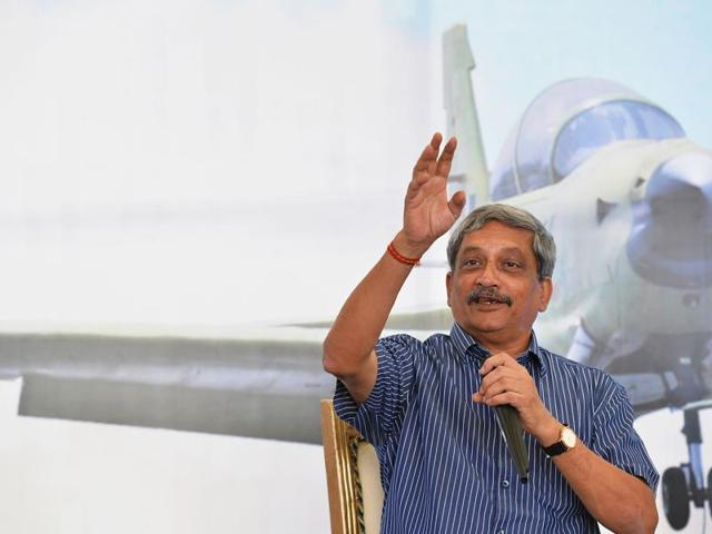 Defence minister Manohar Parrikar talks onstage during a test flight of the HTT-40 aircraft in Bangalore on Friday.