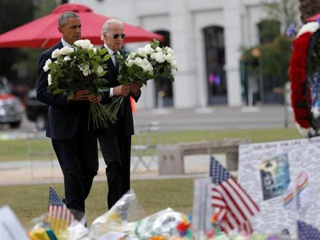 US President Barack Obama and vice president Joe Biden place flowers for victims of the mass shooting at Pulse gay nightclub at a memorial in Florida on Thursday.
