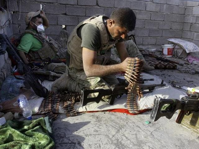 An Iraqi soldier assembles his weapons during clashes in Fallujah, Iraq. Fallujah has been locked in a cycle of conflict since 2003, when it emerged as a bastion of the insurgency against the Americans.